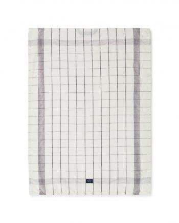 Klassisk kökshandduk av ekologisk bomull och linne. Kökshandduken är vit med mörkgrå rutmönster. Handduken har en ögla för upphängning samt lexingtons logga sydd fram på.